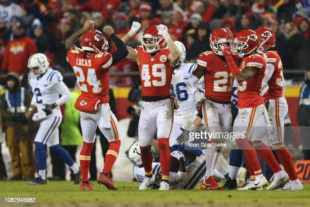 Kansas City Chiefs defensive back Daniel Sorensen celebrates with strong safety Jordan Lucas after making a third down stop in the third quarter of...