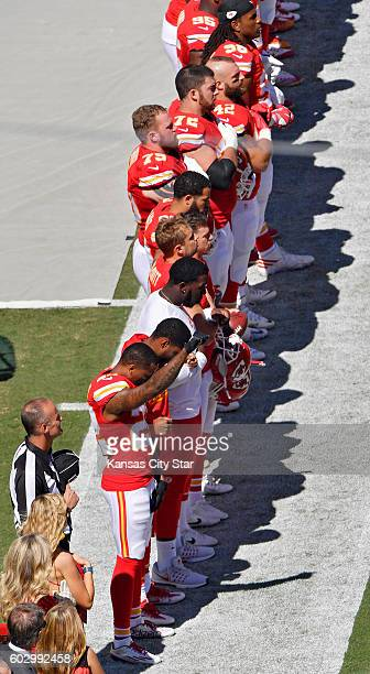 Kansas City Chiefs defensive back Marcus Peters raises his fist in the air as the National Anthem plays before Sunday's football game against the San...