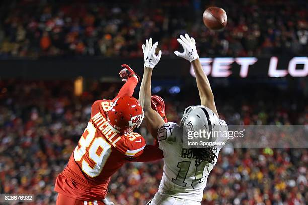 Kansas City Chiefs defensive back Terrance Mitchell defends a fourth down pass attempt to Oakland Raiders wide receiver Seth Roberts late in the...