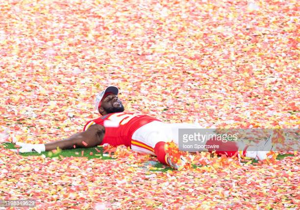 Kansas City Chiefs Defensive End Demone Harris lays on field of confetti as he celebrates winning the NFL Super Bowl LIV game against the San...