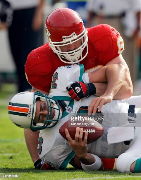 Kansas City Chiefs defensive end Jared Allen sacks Miami Dolphins quarterback Joey Harrington in the third quarter. The Dolphins defeated the Chiefs,...