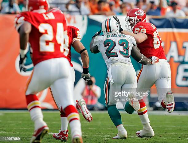 Kansas City Chiefs defensive end Jared Allen stiff-armed Miami Dolphins running back Ronnie Brown , as he returns a Dolphins' fumble for 20 yards in...