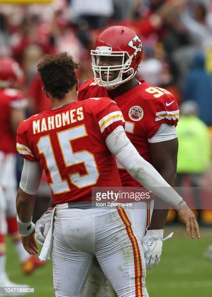 Kansas City Chiefs defensive tackle Chris Jones celebrates with quarterback Patrick Mahomes after Jones intercepted and returned a pass for a...