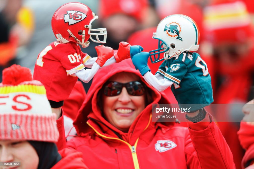 A Kansas City Chiefs fan boxes with team puppets from the stands before the game between the Miami Dolphins and Kansas City Chiefs at Arrowhead Stadium on December 24, 2017 in Kansas City, Missouri.