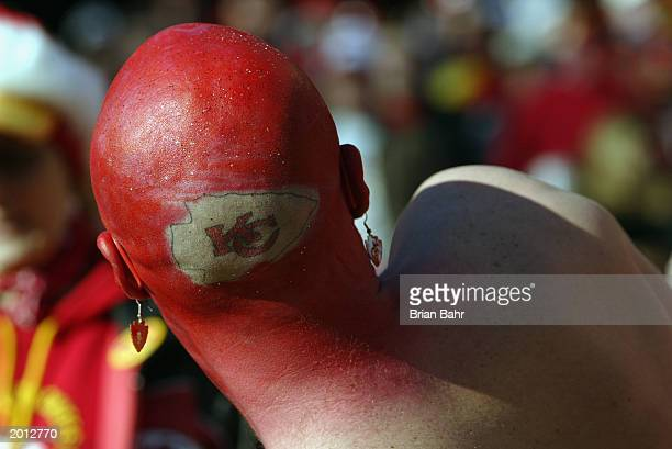 Kansas City Chiefs fan shows his team spirit as he paints himself in Chiefs logo and colors during the NFL game against the San Diego Chargers at...