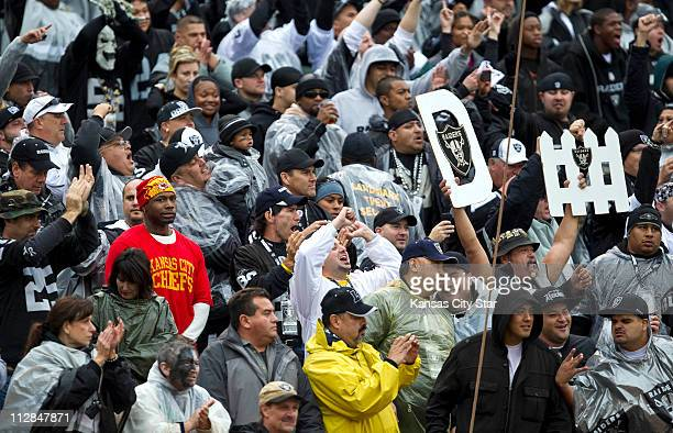 A Kansas City Chiefs fan watches the action from the end zone while surrounded by Oakland Raiders fans The Raiders defeated the Chiefs 2320 in...