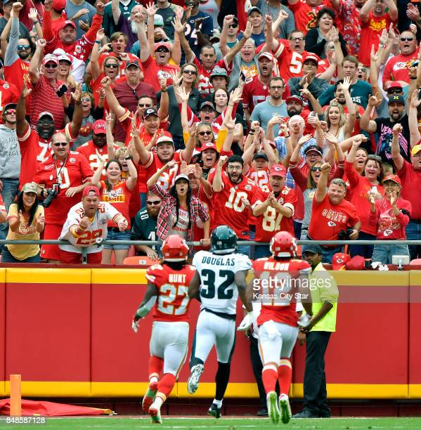 Kansas City Chiefs fans celebrate as running back Kareem Hunt runs into the end zone for a touchdown in the third quarter against the Philadelphia...