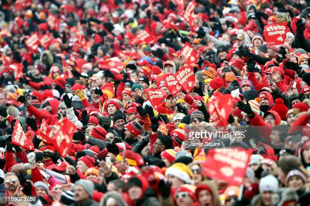 Kansas City Chiefs fans cheer on their team against the Houston Texans in the AFC Divisional playoff game at Arrowhead Stadium on January 12 2020 in...
