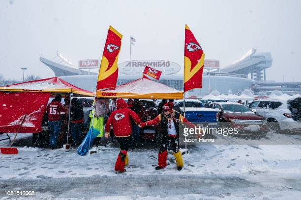 Kansas City Chiefs fans dance in a snowfilled parking lot while tailgating prior to the AFC Divisional Round playoff game between the Kansas City...