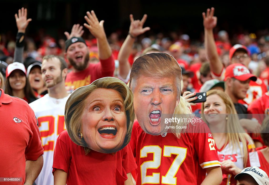 Kansas City Chiefs fans wear Hillary Clinton and Donald Trump masks during the game bethween the Chiefs and the New York Jets at Arrowhead Stadium on September 25, 2016 in Kansas City, Missouri.