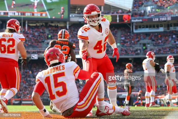Kansas City Chiefs fullback Anthony Sherman helps up Kansas City Chiefs quarterback Patrick Mahomes after an incomplete pass during the first quarter...