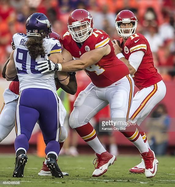 Kansas City Chiefs guard Jeffrey Linkenbach blocks Minnesota Vikings defensive end Brian Robison in the first quarter in preseason action on Saturday...