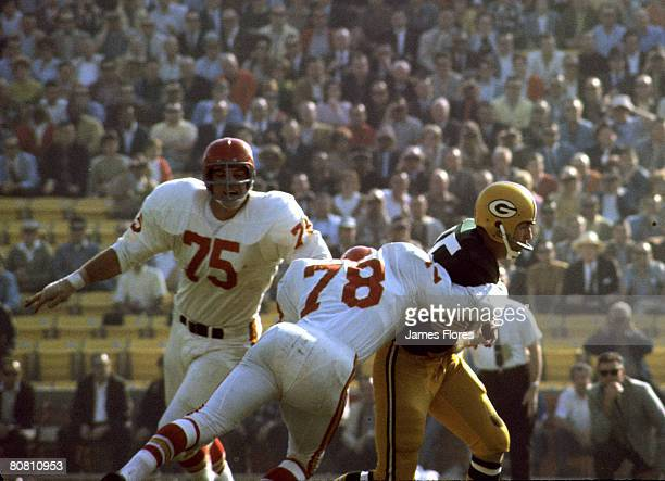 Kansas City Chiefs Hall of Fame linebacker Bobby Bell sacks Green Bay Packers Hall of Fame quarterback Bart Starr during Super Bowl I a 3510 Packers...