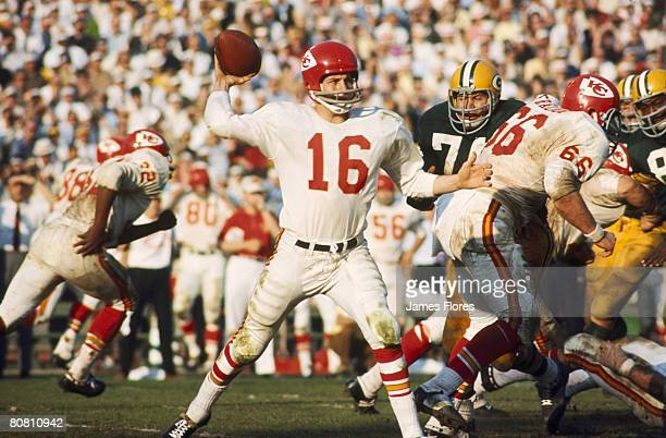 Kansas City Chiefs Hall of Fame quarterback Len Dawson fires a pass duringGreen Bay Packers Hall of Fame fullback Jim Taylor takes the handoff from...