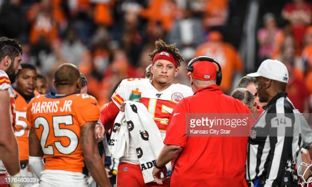 Kansas City Chiefs head coach Andy Reid and players from both the Chiefs and the Denver Broncos meet Chiefs quarterback Patrick Mahomes as he comes...