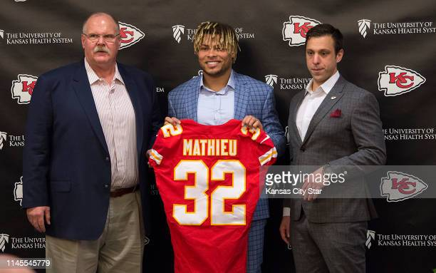 Kansas City Chiefs head coach Andy Reid left and general manager Brett Veach right introduce safety Tyrann Mathieu in the Stram Theater in Kansas...