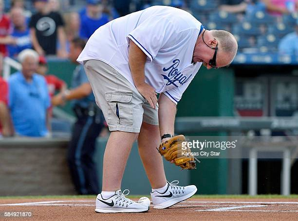 Kansas City Chiefs head coach Andy Reid tried to catch the first pitch from his wife Tammy Reid before the game against the Kansas City Royals on...