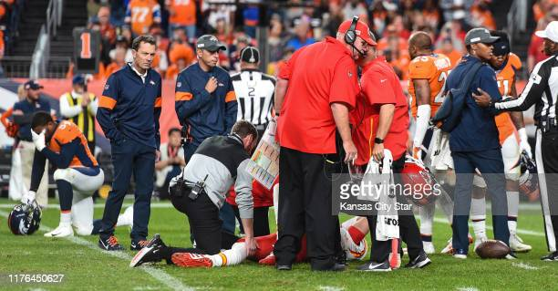 Kansas City Chiefs head coach Andy Reid watches while trainers check on Kansas City Chiefs quarterback Patrick Mahomes after he injured his knee in...