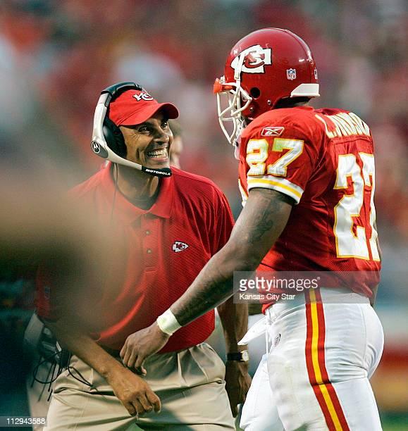 Kansas City Chiefs head coach Herm Edwards congratulates running back Larry Johnson after scoring a first quarter touchdown against the St Louis Rams...