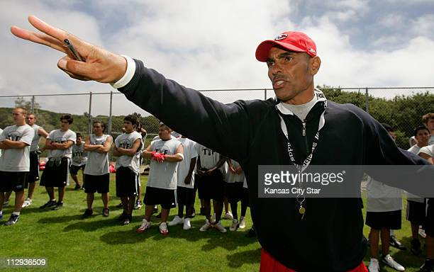 Kansas City Chiefs head coach Herm Edwards leads his youth football camp in Seaside California on July 3 2006