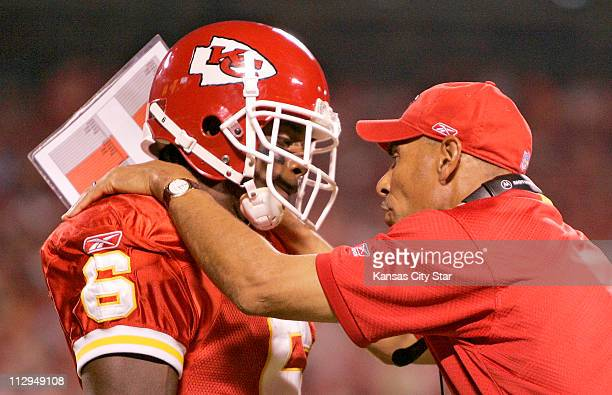 Kansas City Chiefs head coach Herm Edwards talks with Nate Curry in the second quarter against the New Orleans Saints during NFL preseason action at...