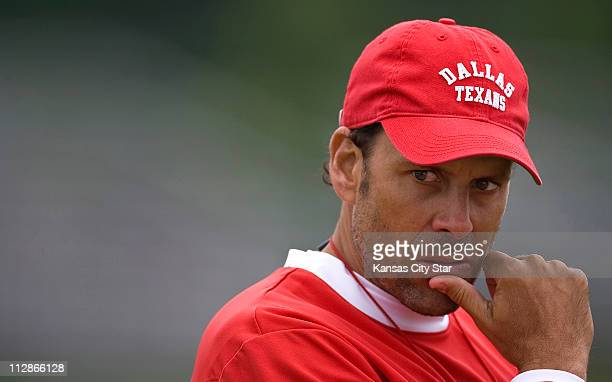 Kansas City Chiefs head coach Todd Haley pauses after morning practice at the team's training camp, Wednesday, August 19 on the campus of the...