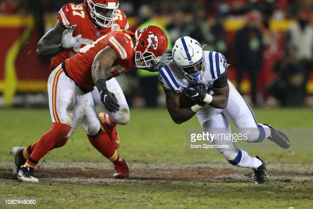 Kansas City Chiefs inside linebacker Anthony Hitchens tackles Indianapolis Colts running back Marlon Mack for a 3yard gain in the third quarter of an...