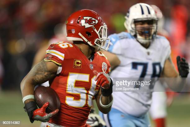 Kansas City Chiefs inside linebacker Derrick Johnson looks back at Tennessee Titans offensive tackle Jack Conklin as he returns a fumble by running...