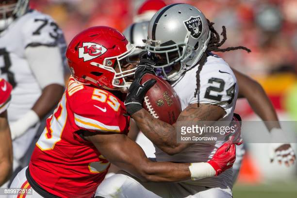 Kansas City Chiefs inside linebacker Reggie Ragland and Oakland Raiders running back Marshawn Lynch collide during the NFL AFC West Division game...