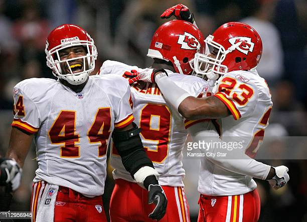 Kansas City Chiefs' Jarrad Page Bernard Pollard center and Patrick Surtain celebrate after stopping the St Louis Rams offense on downs late in the...