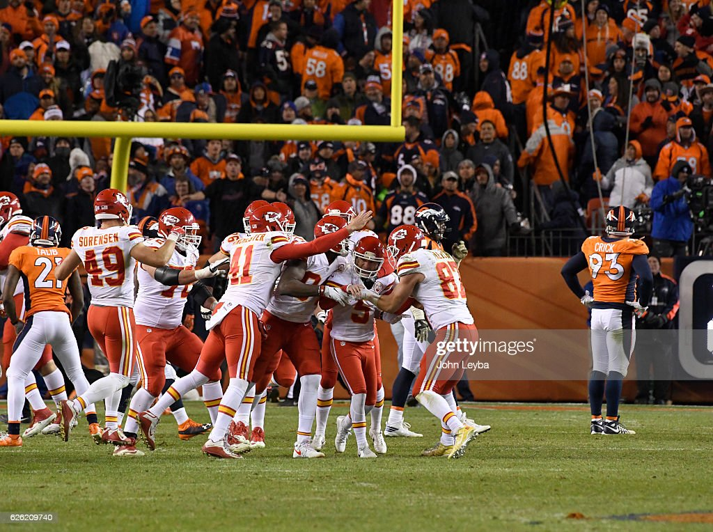 Kansas City Chiefs kicker Cairo Santos (5) celebrates his winning field goal in overtime with Kansas City Chiefs tight end Demetrius Harris (84) and Kansas City Chiefs tight end Travis Kelce (87) and Kansas City Chiefs long snapper James Winchester (41) against the Denver Broncos November 27, 2016 at Sports Authority Field at Mile High Stadium. Kansas City Chiefs defeated the Denver Broncos 30-27 for the overtime win.
