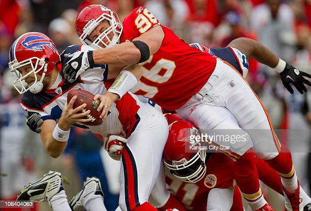 Kansas City Chiefs linebacker Andy Studebaker sacked Buffalo Bills quarterback Ryan Fitzpatrick with help from teammate Tamba Hail lower tight in the...