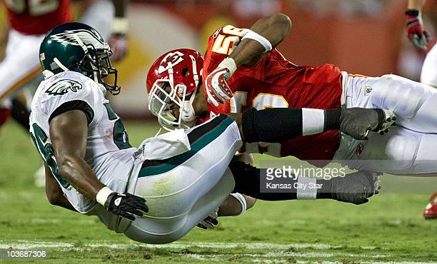 Kansas City Chiefs linebacker Derrick Johnson forces the ball out of the hands of Philadelphia Eagles running back Mike Bell on a screen pass late in...