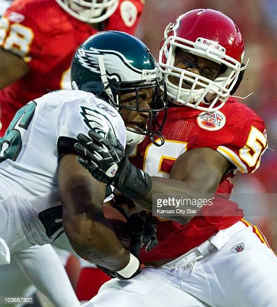 Kansas City Chiefs linebacker Derrick Johnson stops Philadelphia Eagles running back Mike Bell in the second quarter at Arrowhead Stadium in Kansas...