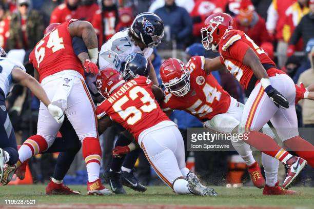 Kansas City Chiefs Mike Pennel Anthony Hitchens and Damien Wilson tackle Tennessee Titans running back Derrick Henry in the third quarter of the AFC...