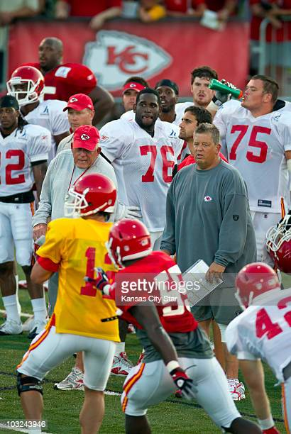 Kansas City Chiefs offensive coordinator Charlie Weis right center in grey shirt watched quarterback Brodie Croyle lower left in yellow during drills...