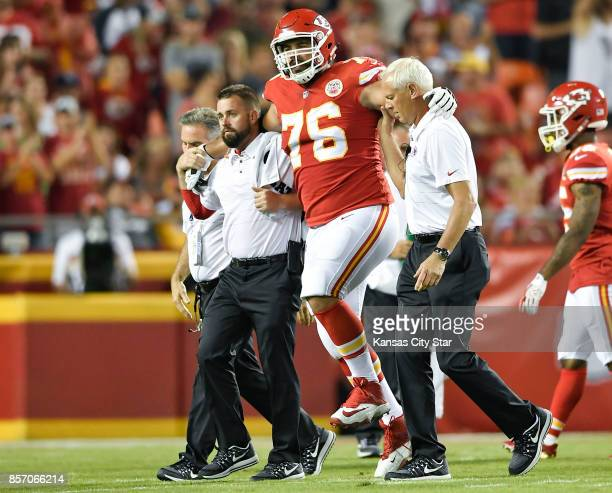 Kansas City Chiefs offensive guard Laurent DuvernayTardif is helped off the field by the training staff in the first quarter during the Kansas City...
