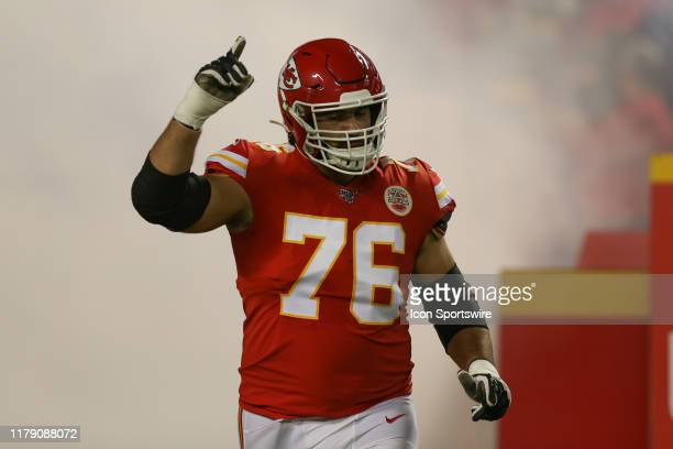 Kansas City Chiefs offensive guard Laurent Duvernay-Tardif points up as he runs onto the field before an NFL game between the Green Bay Packers and...