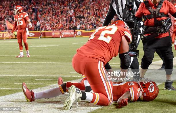 Kansas City Chiefs offensive tackle Eric Fisher performs mock CPR on wide receiver Tyreek Hill after his fourth quarter touchdown against the...