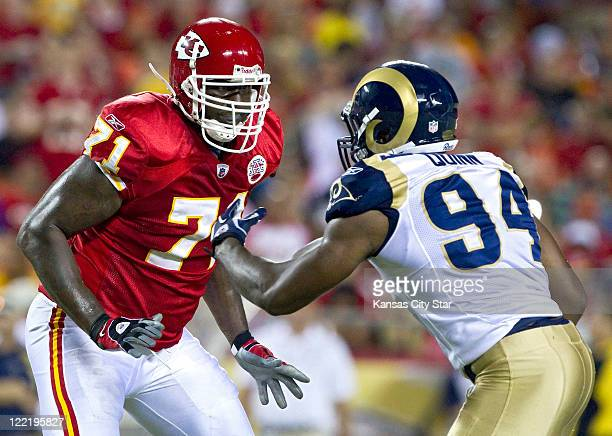 Kansas City Chiefs offensive tackle Jared Gaither keeps St Louis Rams defensive end Robert Quinn away from the quarterback during the third quarter...