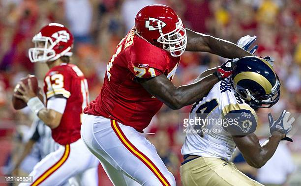 Kansas City Chiefs offensive tackle Jared Gaither protects quarterback Ricky Stanzi by keeping St Louis Rams defensive end Robert Quinn away during...