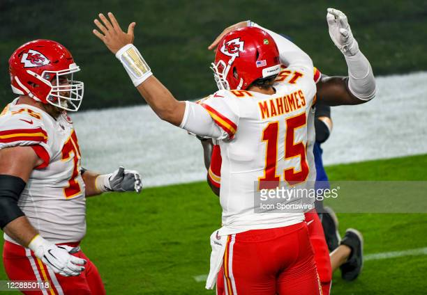 Kansas City Chiefs offensive tackle Mike Remmers congratulates quarterback Patrick Mahomes after his touchdown run during the Kansas City Chiefs game...
