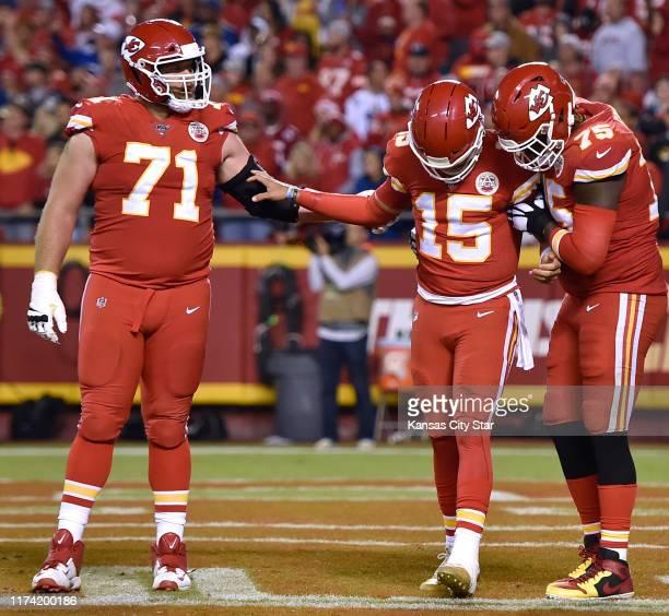 Kansas City Chiefs offensive tackle Mitchell Schwartz and Kansas City Chiefs offensive tackle Cameron Erving help Kansas City Chiefs quarterback...