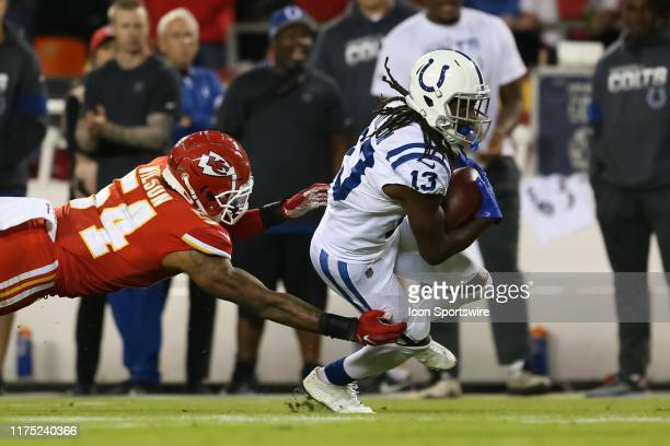 Kansas City Chiefs outside linebacker Damien Wilson dives but can't tackle Indianapolis Colts wide receiver TY Hilton on a 13yard reception in the...
