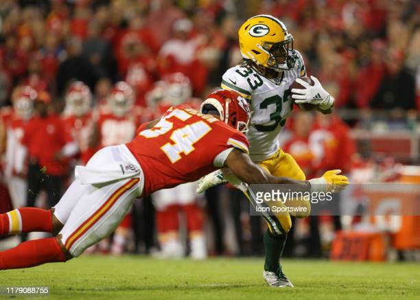 Kansas City Chiefs outside linebacker Damien Wilson tackles Green Bay Packers running back Aaron Jones in the first quarter of an NFL game between...