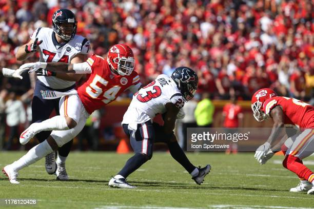 Kansas City Chiefs outside linebacker Damien Wilson tackles Houston Texans running back Carlos Hyde in the first quarter of an NFL matchup between...