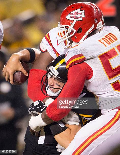 Kansas City Chiefs outside linebacker Dee Ford and defensive tackle Chris Jones are tangled with Pittsburgh Steelers quarterback Ben Roethlisberger...