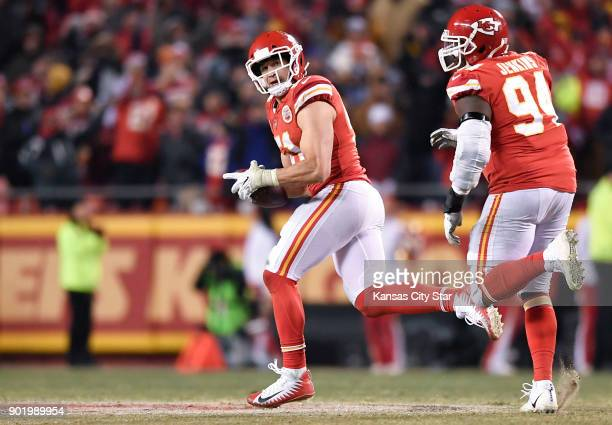 Kansas City Chiefs outside linebacker Frank Zombo looks over his shoulder after picking up the ball during a failed twopoint conversion attempt by...