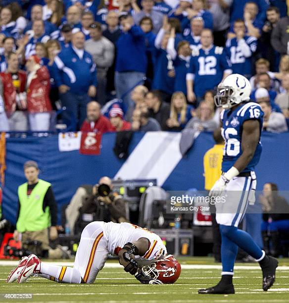 Kansas City Chiefs outside linebacker Justin Houston beats the turf after being injured in the fourth quarter as Indianapolis Colts wide receiver...