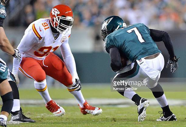 Kansas City Chiefs outside linebacker Tamba Hali zeroes in on Philadelphia Eagles quarterback Michael Vick for a sack in the first quarter at Lincoln...